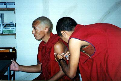 A monk receiving an inoculation