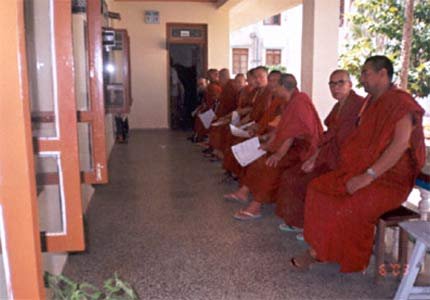 Monks waiting for services